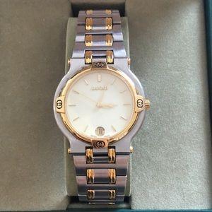 Women's two tone Gucci watch